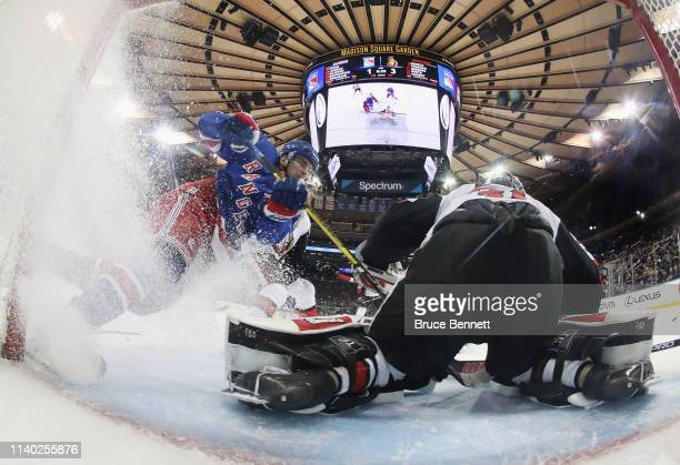 Pavel Buchnevich of the New York Rangers is stopped by Anders Nilsson of the Ottawa Senators during the second period at Madison Square Garden on...