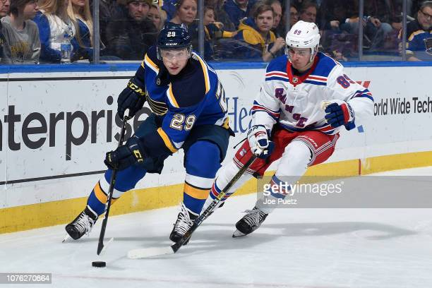Pavel Buchnevich of the New York Rangers pressures Vince Dunn of the St Louis Blues at Enterprise Center on December 31 2018 in St Louis Missouri