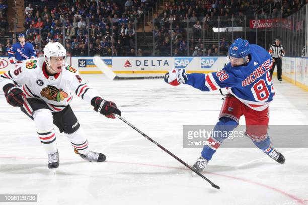Pavel Buchnevich of the New York Rangers shoots the puck against Connor Murphy of the Chicago Blackhawks at Madison Square Garden on January 17 2019...