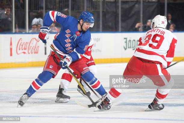 Pavel Buchnevich of the New York Rangers skates with the puck against Anthony Mantha of the Detroit Red WIngs at Madison Square Garden on November 24...