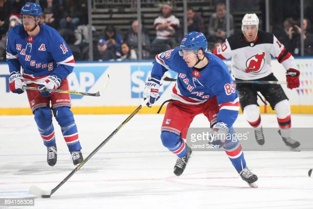 Pavel Buchnevich of the New York Rangers skates with the puck against the New Jersey Devils at Madison Square Garden on December 9 2017 in New York...