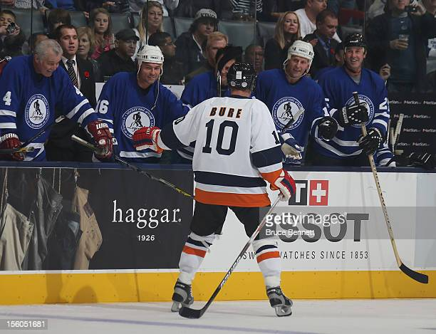 Pavel Bure is greeted by players as he skates on to the ice for the Hockey Hall of Fame Legends Game at the Air Canada Centre on November 11 2012 in...