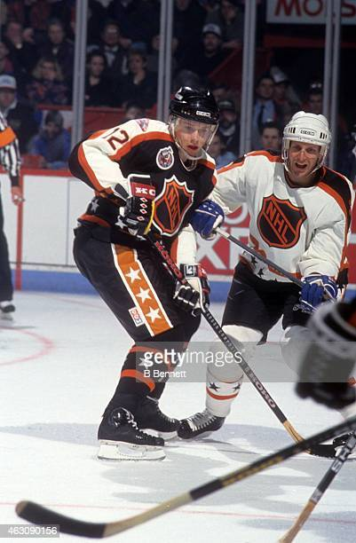 Pavel Bure of the Campbell Conference and the Vancouver Canucks battles with Zarley Zalapski of the Wales Conference and the Hartford Whalers during...