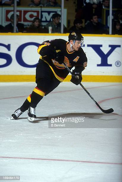 Pavel Bure of the Vancouver Canucks skates on the ice during an NHL game against the Toronto Maple Leafs on November 26, 1996 at the Maple Leaf...