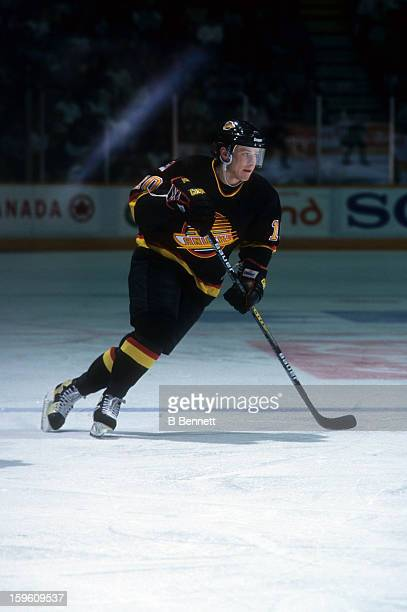 Pavel Bure of the Vancouver Canucks skates on the ice during an NHL game against the Winnipeg Jets on March 14, 1995 at the Winnipeg Arena in...