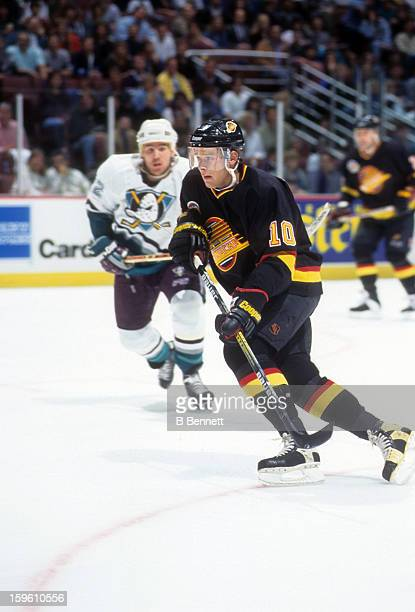 Pavel Bure of the Vancouver Canucks skates on the ice during an NHL game against the Mighty Ducks of Anaheim on February 17 1995 at the Arrowhead...
