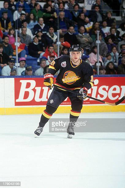 Pavel Bure of the Vancouver Canucks skates on the ice during an NHL game against the New York Islanders on January 9, 1993 at the Nassau Coliseum in...