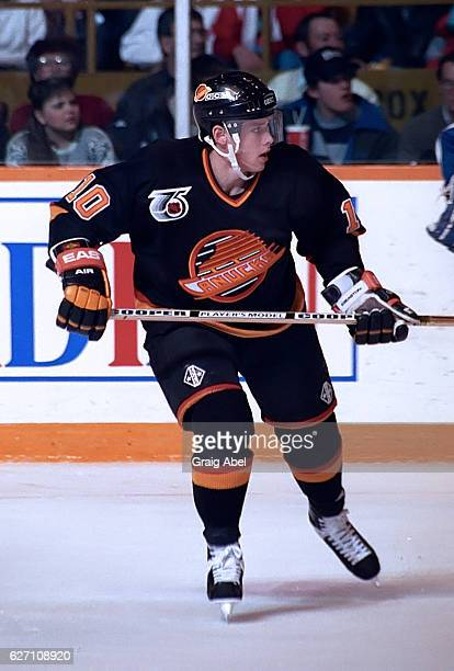 Pavel Bure of the Vancouver Canucks skates up ice against the Toronto Maple Leafs during NHL game action on December 7 1991 at Maple Leaf Gardens in...