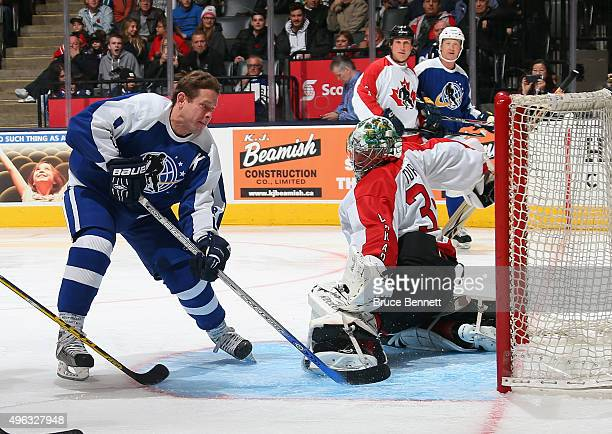 Pavel Bure scores on Marty Turco at the Legends Classic game at the Air Canada Centre on November 8 2015 in Toronto Ontario Canada