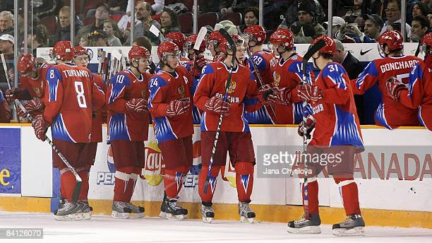 Pavel Chernov of Russia celebrates his second period goal against Latvia with his team mates Viatcheslav Voinov Sergei Andronov Kirill Petrov the...