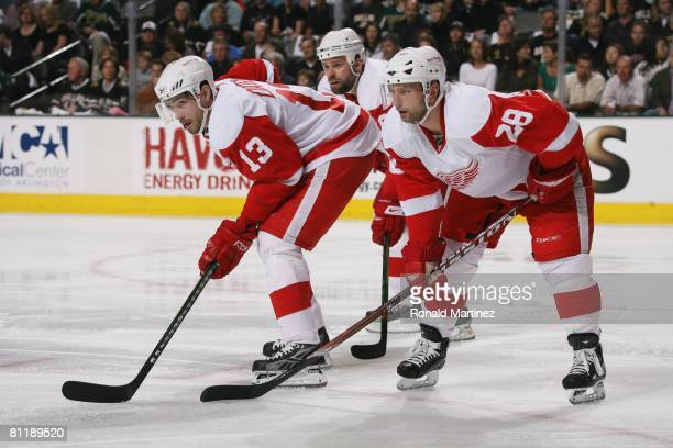 Pavel Datsyuk Brian Rafalski and Tomas Holmstrom of the Detroit Red Wings get set on a face off against the Dallas Stars during game six of the...