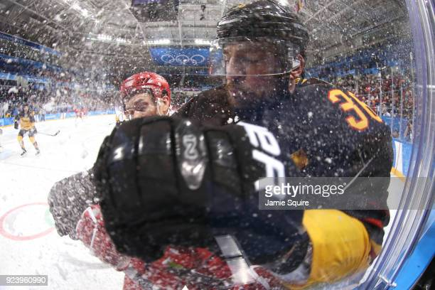 Pavel Datsyuk of Olympic Athlete from Russia collides with Yannic Seidenberg of Germany in the third period during the Men's Gold Medal Game on day...