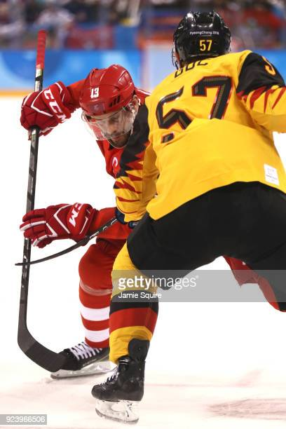 Pavel Datsyuk of Olympic Athlete from Russia competes for the puck against Marcel Goc of Germany in the third period during the Men's Gold Medal Game...