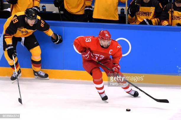 Pavel Datsyuk of Olympic Athlete from Russia controls the puck against David Wolf of Germany in the third period during the Men's Gold Medal Game on...