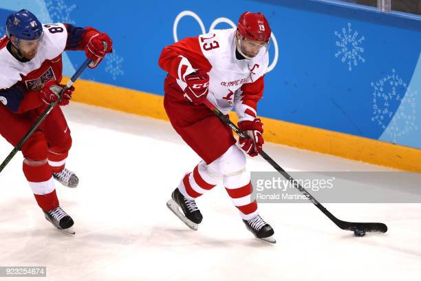 Pavel Datsyuk of Olympic Athlete from Russia controls the puck against Jakub Nakladal of the Czech Republic in the third period during the Men's...