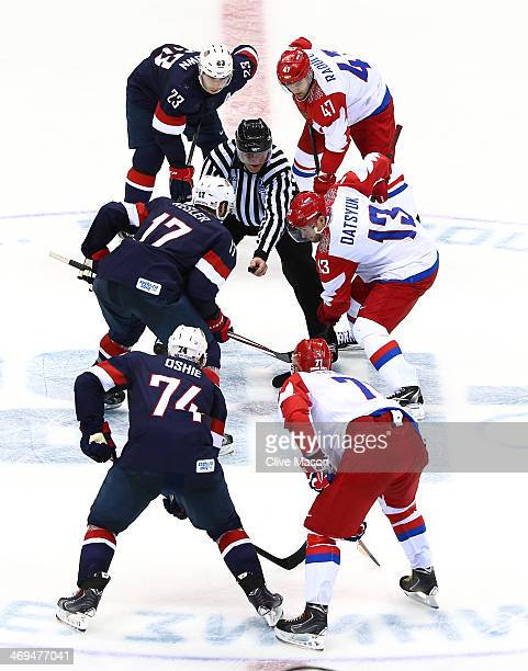 Pavel Datsyuk of Russia and Ryan Kesler of the United States face off during the Men's Ice Hockey Preliminary Round Group A game on day eight of the...
