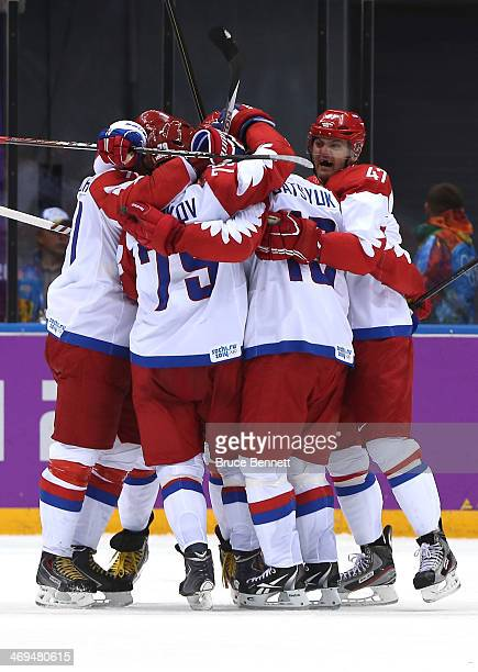 Pavel Datsyuk of Russia celebrates with teammates after scoring a thirdperiod goal against the United States during the Men's Ice Hockey Preliminary...