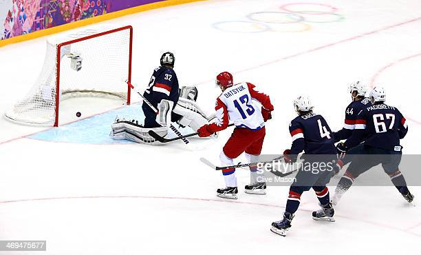 Pavel Datsyuk of Russia scores a goal against Jonathan Quick of the United States during the Men's Ice Hockey Preliminary Round Group A game on day...