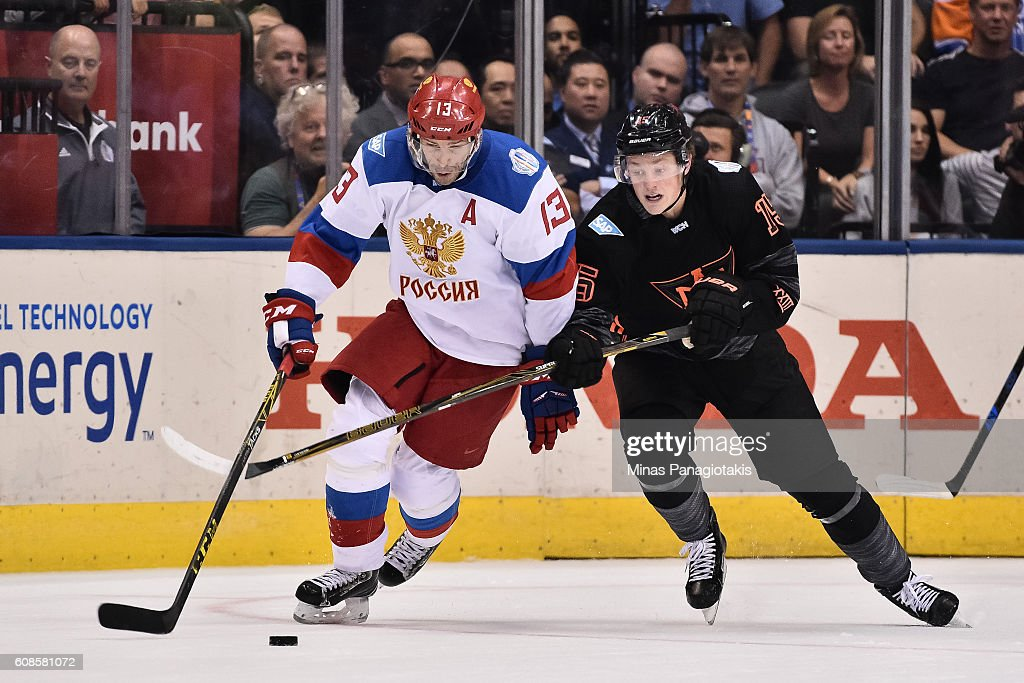 Pavel datsyuk pavel datsyuk pavel datsyuk 13 of team russia pulls the puck away from jack eichel 15 voltagebd Choice Image