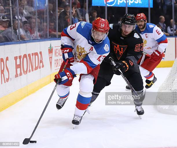 Pavel Datsyuk of Team Russia stickhandles the puck away from Ryan Murray of Team North America during the World Cup of Hockey 2016 at Air Canada...