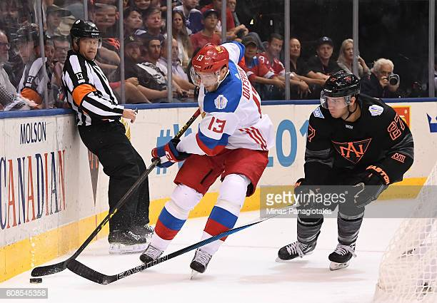 Pavel Datsyuk of Team Russia stickhandles the puck with pressure from Ryan Murray of Team North America during the World Cup of Hockey 2016 at Air...