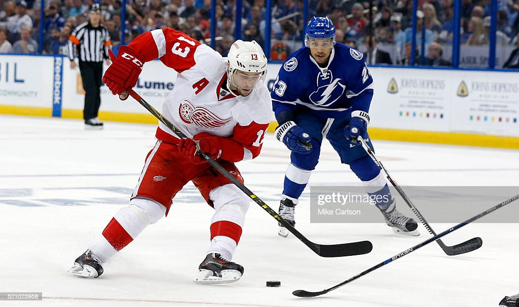 Pavel Datsyuk #13 of the Detroit Red Wings avoids the defense of J.T. Brown #23 of the Tampa Bay Lightning during the third period in Game One of the Eastern Conference Quarterfinals during the 2016 NHL Stanley Cup Playoffs at Amalie Arena on April 13, 2016 in Tampa, Florida.