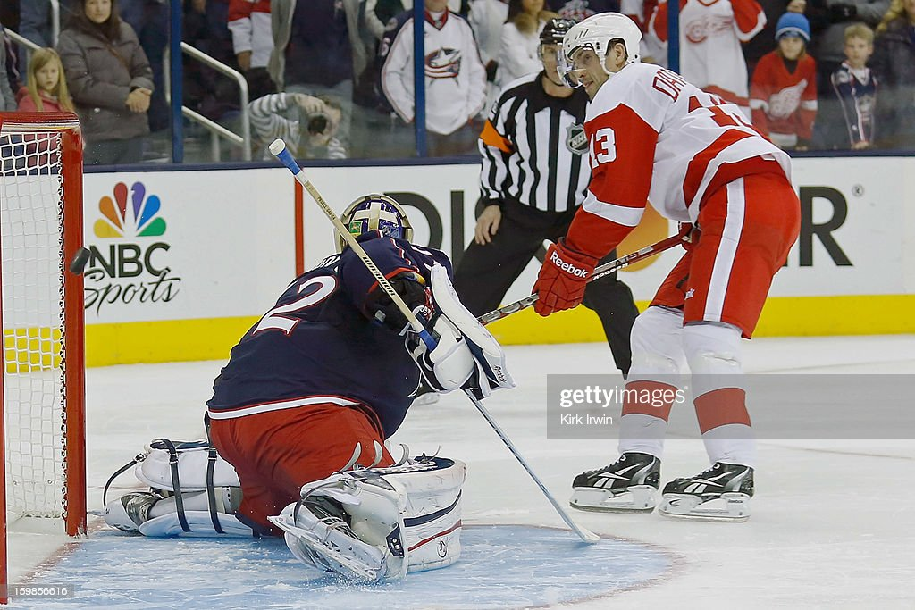 Pavel Datsyuk #13 of the Detroit Red Wings beats Sergei Bobrovsky #72 of the Columbus Blue Jackets but hits the goalpost during the shootout on January 21, 2013 at Nationwide Arena in Columbus, Ohio. Detroit defeated Columbus 4-3 in a shootout.