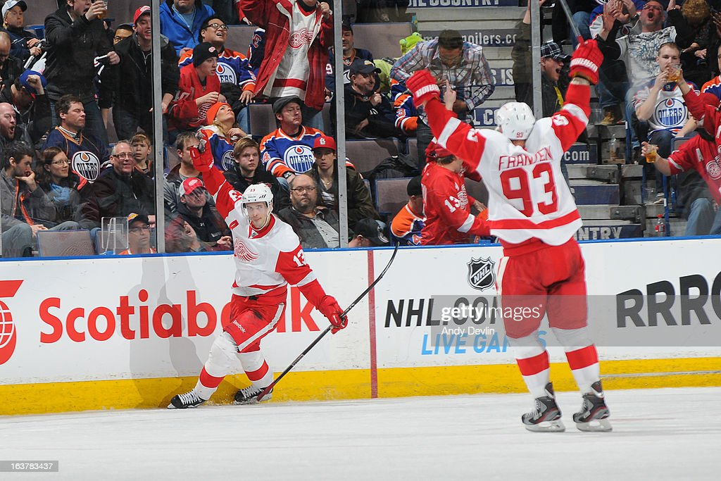 Pavel Datsyuk #13 of the Detroit Red Wings celebrates after scoring the game winning goal in overtime in a game against the Edmonton Oilers on March 15 2013 at Rexall Place in Edmonton, Alberta, Canada.