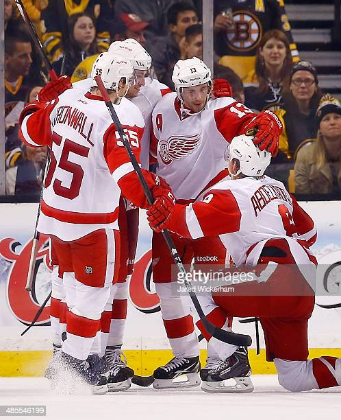 Pavel Datsyuk of the Detroit Red Wings celebrates his goal in the third period with teammate Justin Abdelkader against the Boston Bruins in Game One...