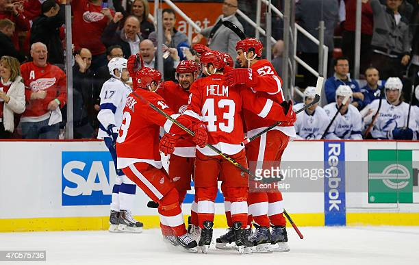 Pavel Datsyuk of the Detroit Red Wings celebrates with his teammates after scoring a first period goal against the Tampa Bay Lightning in Game Three...