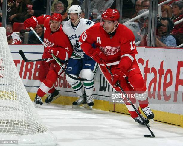 Pavel Datsyuk of the Detroit Red Wings controls the puck behind the net during a NHL game against the Vancouver Canucks at Joe Louis Arena on...