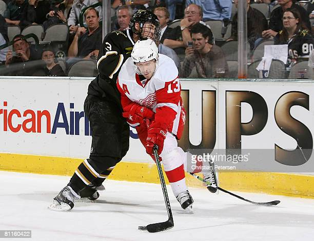 Pavel Datsyuk of the Detroit Red Wings controls the puck under pressure from Stephane Robidas of the Dallas Stars during game six of the Western...