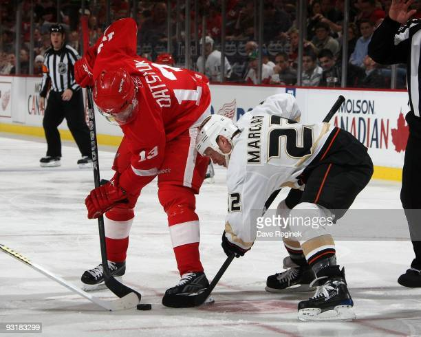 Pavel Datsyuk of the Detroit Red Wings faces off against Todd Marchant of the Anaheim Ducks during a NHL game at Joe Louis Arena on November 14 2009...