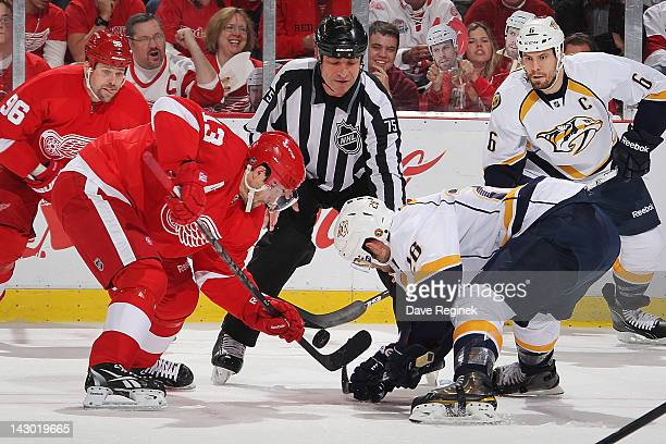 Pavel Datsyuk of the Detroit Red Wings faces off with Paul Gaustad of the Nashville Predators in Game Four of the Western Conference Quarterfinals...