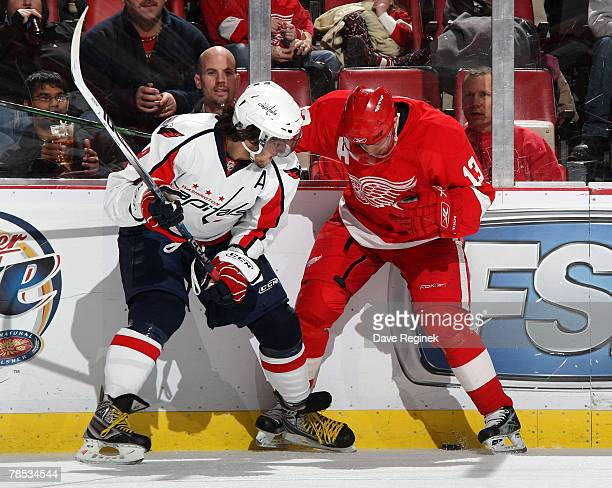 Pavel Datsyuk of the Detroit Red Wings fights for the puck with Alex Ovechkin of the the Washington Capitals during a NHL game on December 17 2007 at...