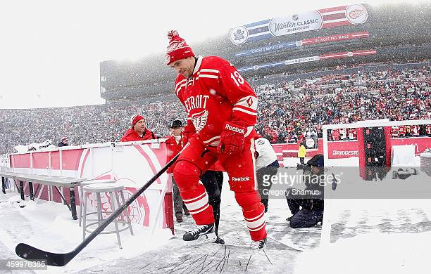 Pavel Datsyuk of the Detroit Red Wings heads out onto the ice prior to the start of the 2014 Bridgestone NHL Winter Classic at Michigan Stadium on...
