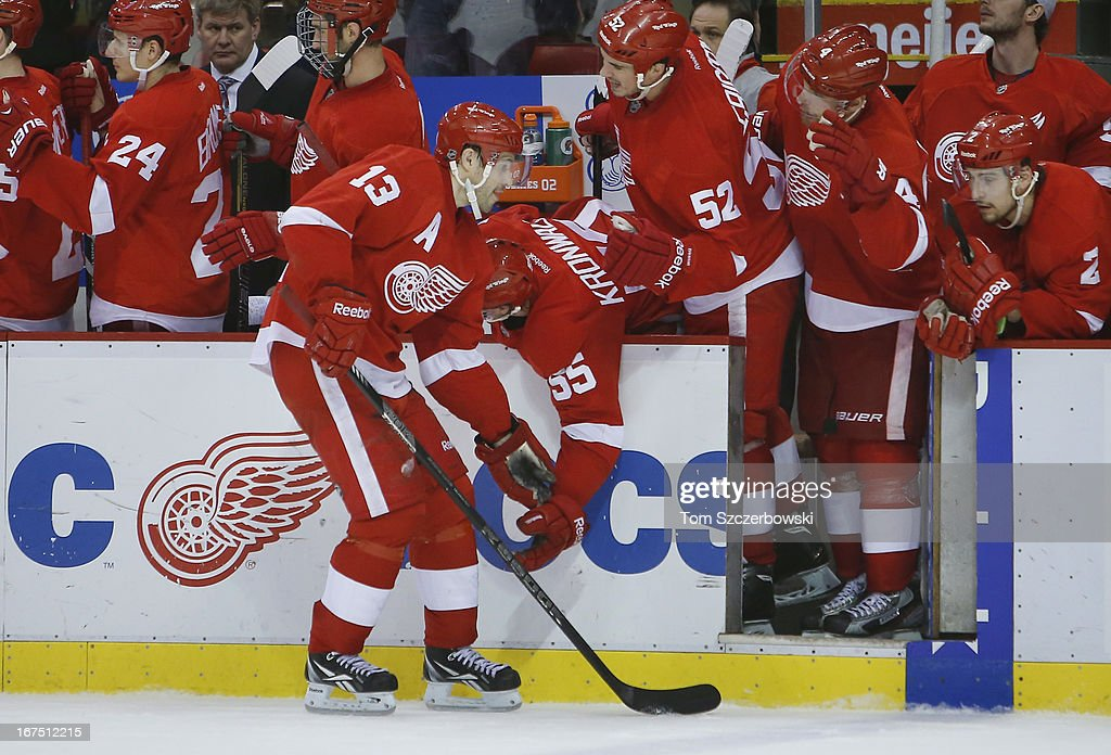 Pavel Datsyuk #13 of the Detroit Red Wings is congratulated by Niklas Kronwall #55 after scoring a goal during an NHL game against the Nashville Predators at Joe Louis Arena on April 25, 2013 in Detroit, Michigan.