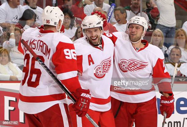 Pavel Datsyuk of the Detroit Red Wings is congratulated by teammates Tomas Holmstrom and Brian Rafalski after Datsyuk scored a third period goal...