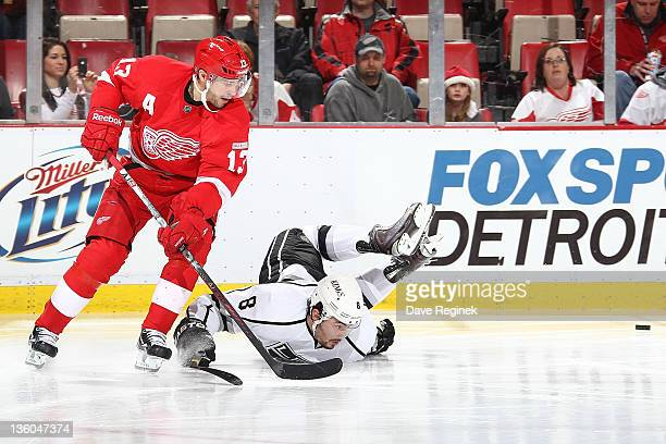 Pavel Datsyuk of the Detroit Red Wings looks to the puck with Drew Doughty of the Los Angeles Kings during an NHL game at Joe Louis Arena on December...