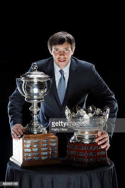 Pavel Datsyuk of the Detroit Red Wings poses with the Frank Selke and Lady Byng trophies following the 2009 NHL Awards at the Palms Casino Resort on...