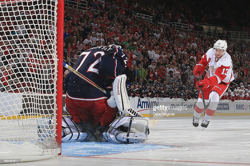 Pavel Datsyuk #13 of the Detroit Red Wings scores a goal on his shoot-out attempt on Sergei Bobrovsky #72 of the Columbus Blue Jackets during an NHL game at Joe Louis Arena on March 10, 2013 in Detroit, Michigan. Columbus won 3-2 in a shoot-out