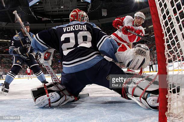 Pavel Datsyuk of the Detroit Red Wings shoots and scores against Goaltender Tomas Vokoun of the Florida Panthers at the BankAtlantic Center on...