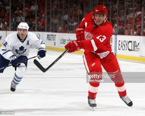 Pavel Datsyuk of the Detroit Red Wings shoots the puck during a NHL preseason game against the Toronto Maple Leafs at Joe Louis Arena on September 25...