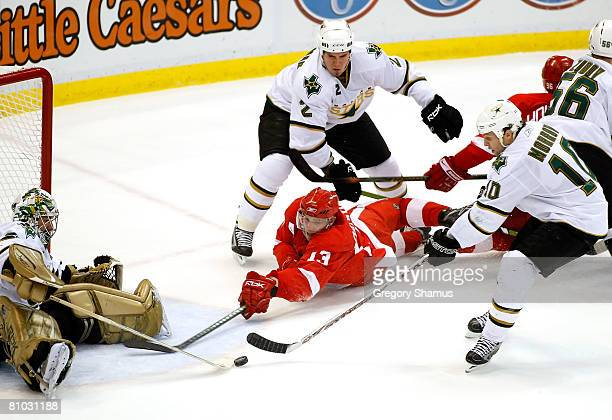 Pavel Datsyuk of the Detroit Red Wings shoots the puck on goaltender Marty Turco of the Dallas Stars as Brenden Morrow and Nicklas Grossman defend...