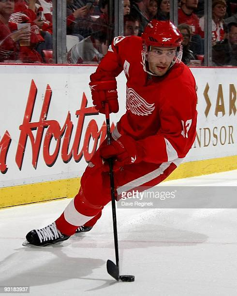 Pavel Datsyuk of the Detroit Red Wings skates around the net with the puck during a NHL game against the Anaheim Ducks at Joe Louis Arena on November...