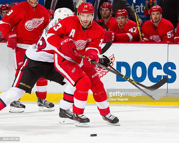 Pavel Datsyuk of the Detroit Red Wings skates up ice with the puck during an NHL game against the Ottawa Senators at Joe Louis Arena on February 10...