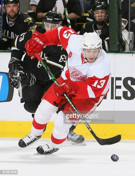 Pavel Datsyuk of the Detroit Red Wings skates with the puck past Mike Ribeiro of the Dallas Stars during game tthree of the Western Conference Finals...