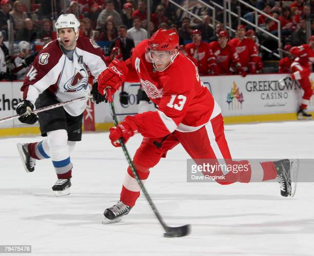 Pavel Datsyuk of the Detroit Red Wings takes a wrist shot in front of Ian Laperriere of the Colorado Avalanche during a NHL game on February 1 2008...