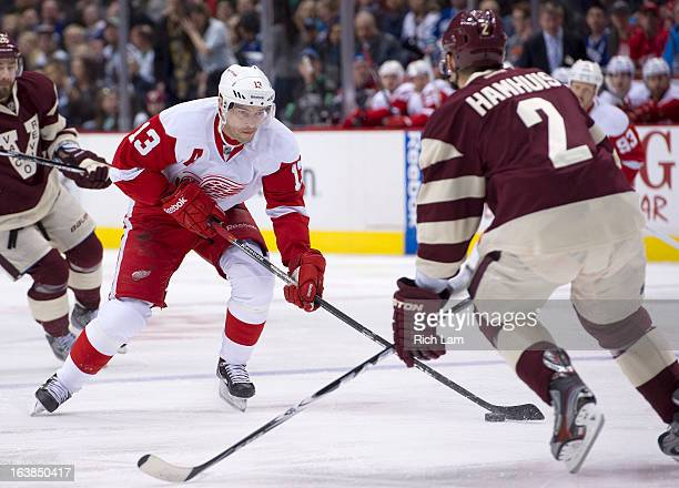 Pavel Datsyuk of the Detroit Red Wings tries to get past Dan Hamhuis of the Vancouver Canucks during the first period of NHL action on March 16 2013...