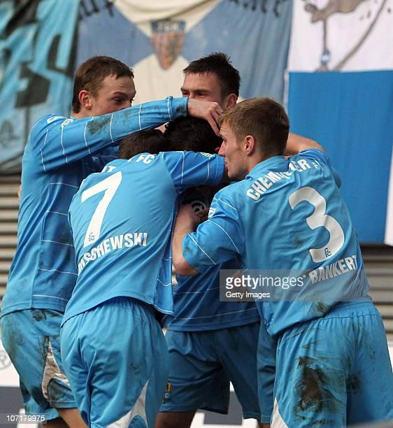 Pavel Dobry of Chemnitz celebrates scoring his team's goal with team mates Matthias Pessolat, Ronny Garbuschweski and Silvio Bankert during the...